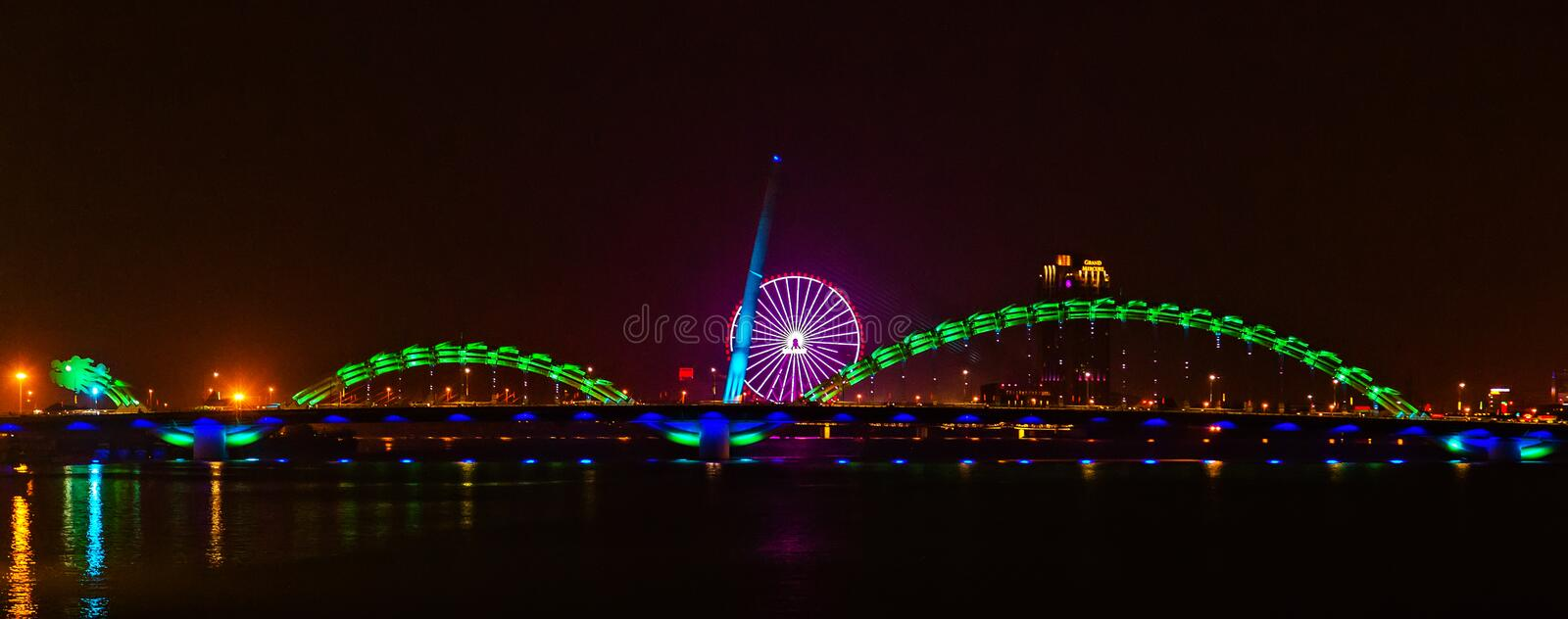 Dragon golden Bridge Han river in Da Nang in Vietnam. Dragon Bridge in the evening as it is illuminated with colourful LED lights, Han river in Da Nang, Vietnam stock photo