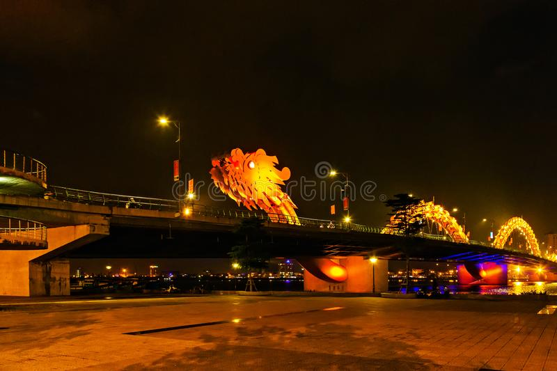 Dragon golden Bridge Han river in Da Nang in Vietnam. Dragon Bridge in the evening as it is illuminated with colourful LED lights, Han river in Da Nang, Vietnam royalty free stock image