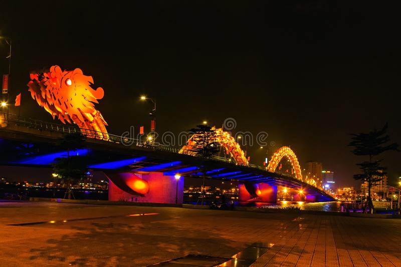 Dragon golden Bridge Han river in Da Nang in Vietnam. Dragon Bridge in the evening as it is illuminated with colourful LED lights, Han river in Da Nang, Vietnam stock image