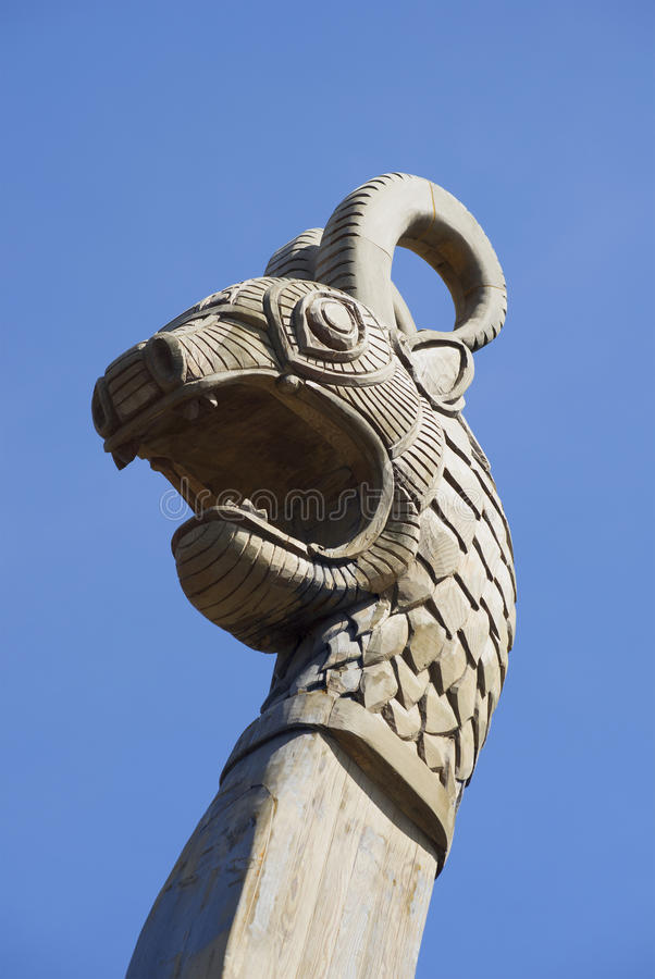 Dragon head - a fragment of a figurehead dragon boat, Viking ship in Vyborg stock photography