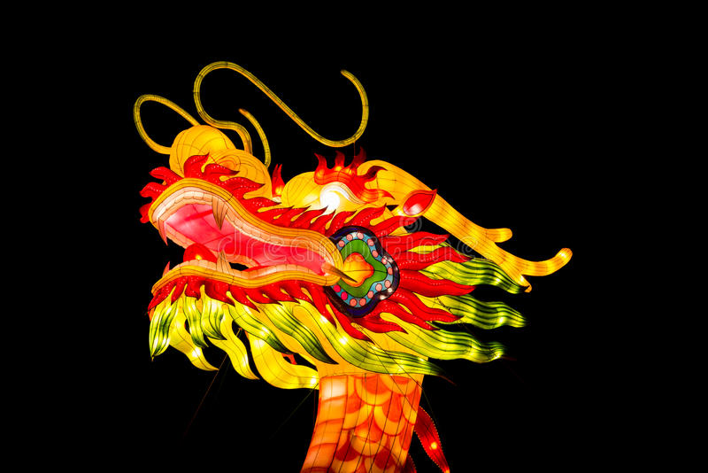 Dragon head lantern on a black background. London, United Kingdom - February 07, 2016: Magical Lantern Festival at Chiswick House And Gardens. A dragon head stock photography