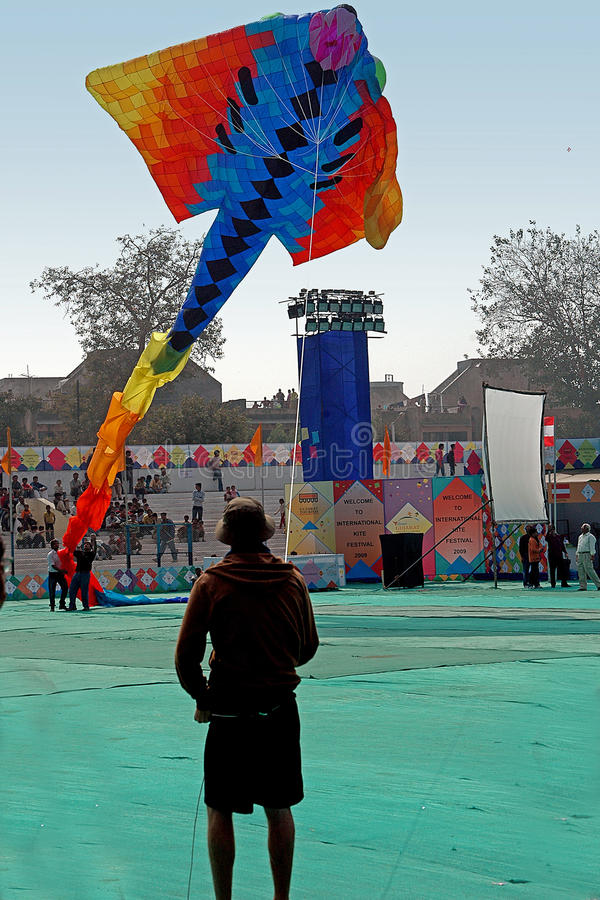Dragon kite flying. A very huge dragon kite flying at International Kite Festival, Ahmedabad celebrated by Govt.of Gujarat royalty free stock image