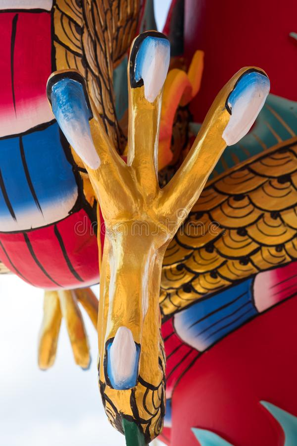 Dragon or monster paw. Golden dragon claw dragon foot statue stock image