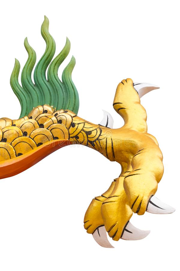 Dragon or monster paw. Golden dragon claw dragon foot statue on white background stock images