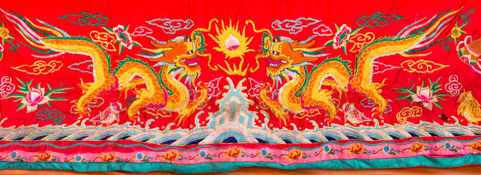 Dragon motif embroider. Dragons motif embroider in Chinese temple royalty free stock photos