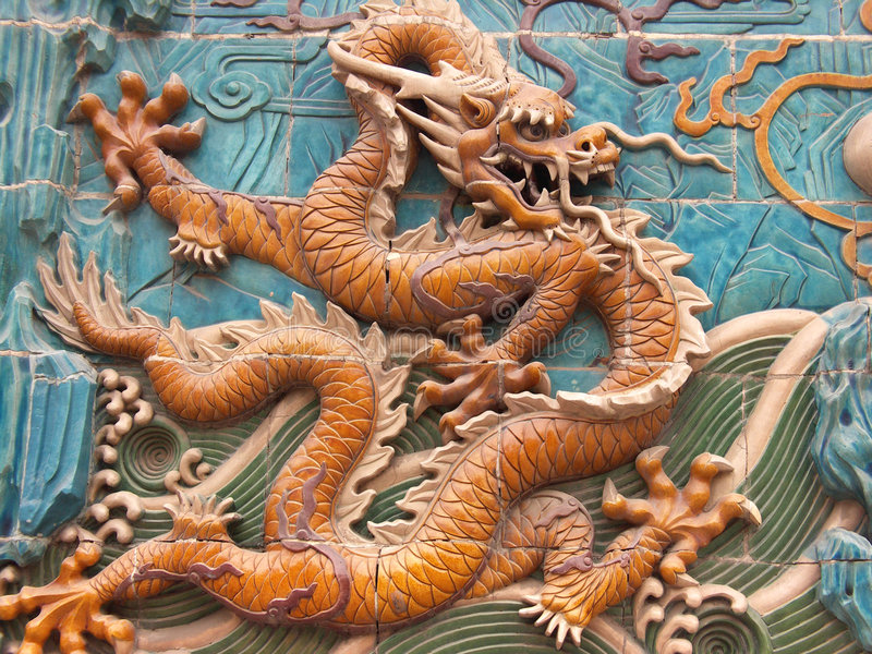 Dragon mural 5. Different colored ancient tiled dragons on a wall. Each dragon has a different position stock photo