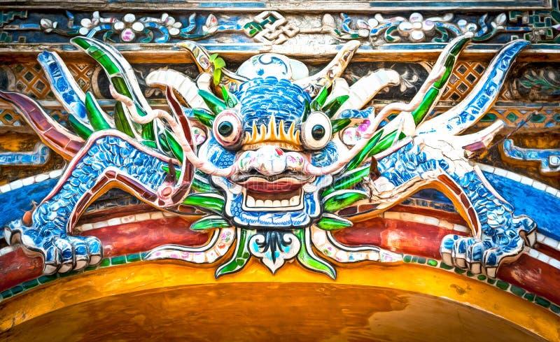 Dragon over gate to Hue citadel. Vietnam, Asia. Dragon face over gate to Hue citadel. Vietnam, Asia stock images