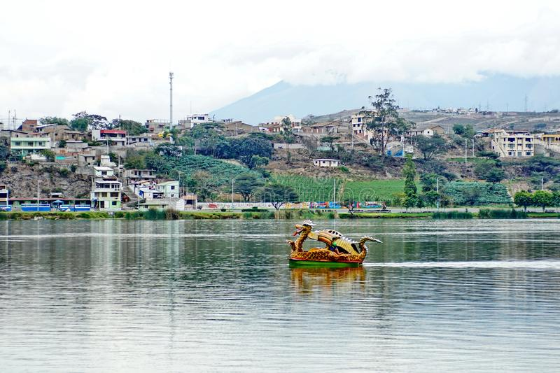 Dragon paddle boat. In the center of Lago Yahuarcocha in Ibarra, Ecuador stock images