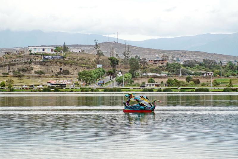 Dragon paddle boat. In the center of Lago Yahuarcocha in Ibarra, Ecuador stock photos