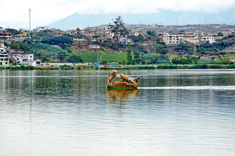 Dragon paddle boat. In the center of Lago Yahuarcocha in Ibarra, Ecuador stock image