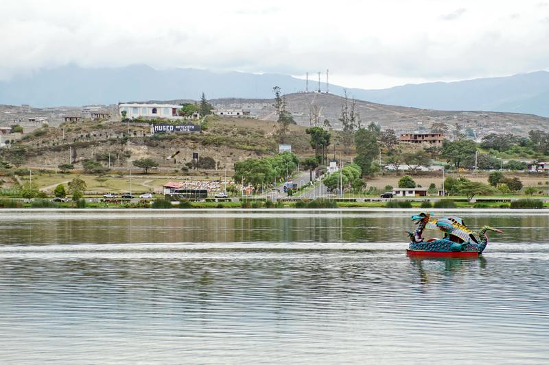 Dragon paddle boat. In the center of Lago Yahuarcocha in Ibarra, Ecuador stock photo