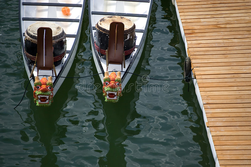 Dragon Rowing Boats. Idling whilst participants get ready for an international dragon boat race in Penang, Malaysia royalty free stock images