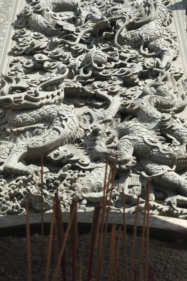 Dragon sculpture behind an incense burner. Yesterday,I travel to visit the most beautiful Chinese temple in a province nearby the capital city of Thailand and royalty free stock images