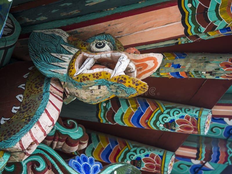 Dragon sculpture in Sungsinjeon shrine in Gyeongju. Architectonic detail of Sungsinjeon shrine - dragon sculpture on the roof stock photo
