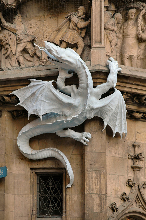 Dragon on the side of City Hall in Munich, Germany. Dragon sculpture on the side of City Hall (Rathaus) in Munich, Germany royalty free stock image