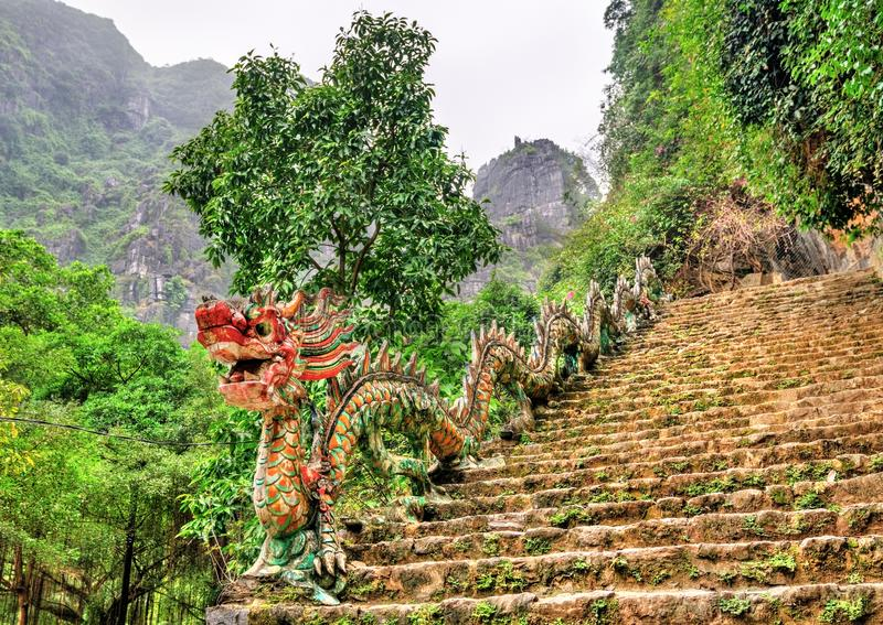 Dragon statue as banister for the stairway of Hang Mua viewpoint near Ninh Binh, Vietnam. Dragon statue as banister for a stariway leading to Hang Mua viewpoint stock photo
