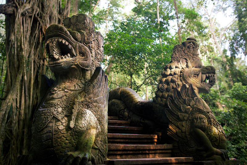 Dragon statues. In Monkey Forest in Ubud, Bali royalty free stock photo