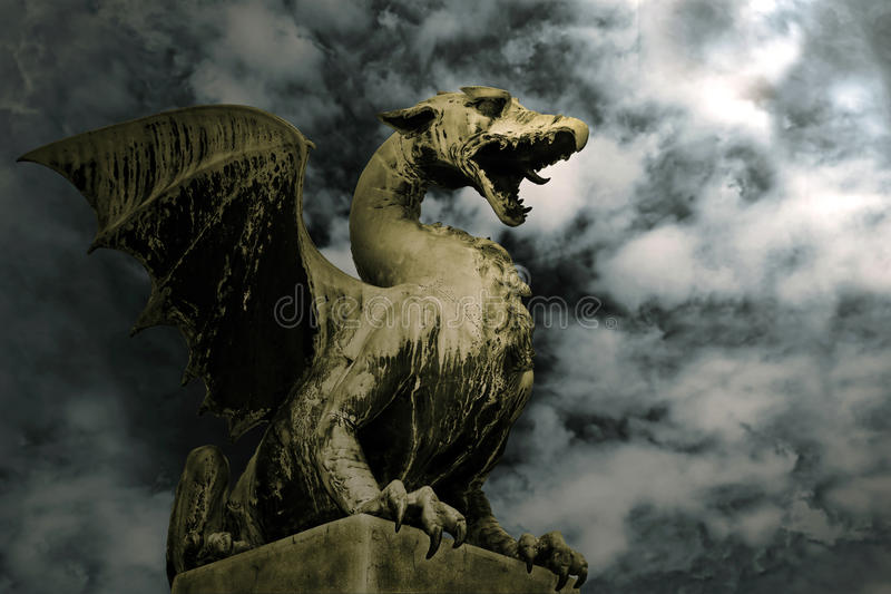 Dragon in stone stock photography