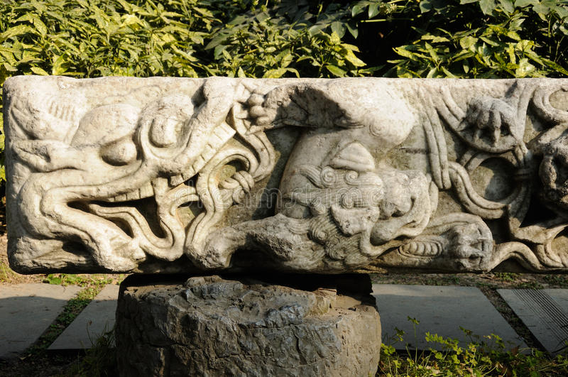 Dragon Stone Tablet. An old carved stone tablet depicting a Chinese dragon in xiaoyaojin park in Hefei China stock image