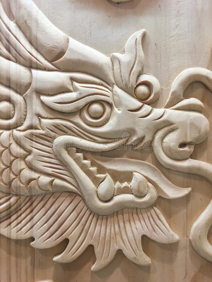 Dragon wooden carving wood Chinese year new sign symbols religion powers leader stock photography