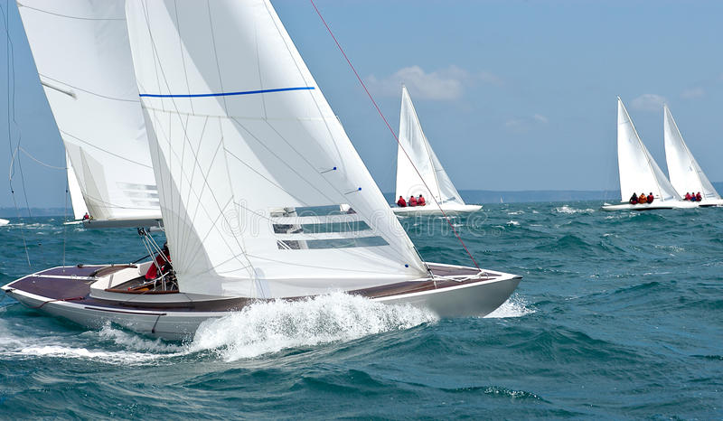 Dragon yacht bow at regatta. Dragon yacht bow with wave and foam at regatta stock photo