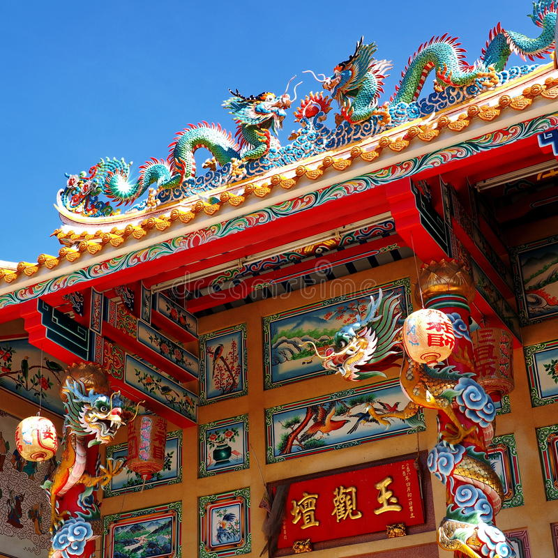 Dragons on a Chinese shrine roof. In Nonthaburi, neigboring province of Thai capital Bangkok royalty free stock images