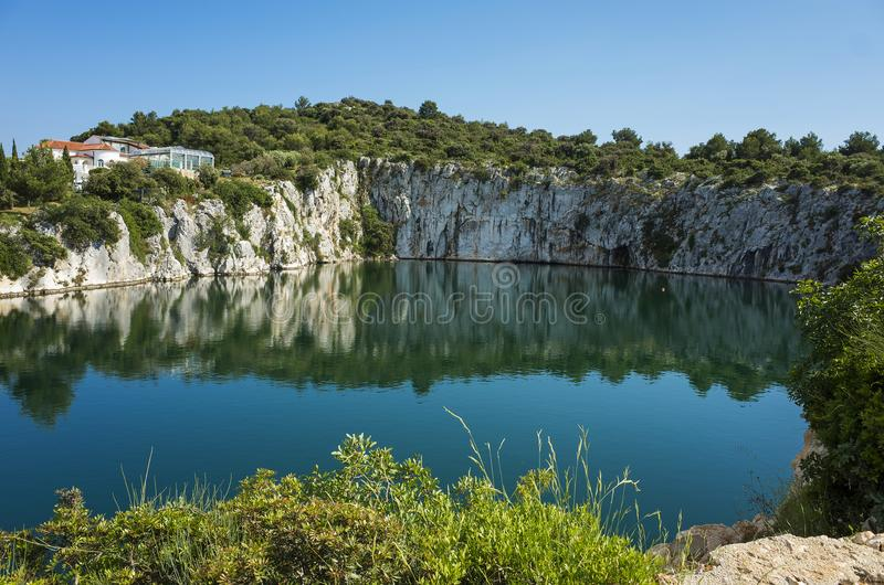 Dragons Eye, Rogoznica Dalmatia Croatia. Beautiful nature and landscape with rocks and cliffs around a small lake. Nice warm sunny spring day with clear blue stock photography