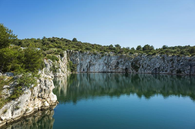 Dragons Eye, Rogoznica Dalmatia Croatia. Beautiful nature and landscape with rocks and cliffs around a small lake. Nice warm sunny spring day with clear blue stock image
