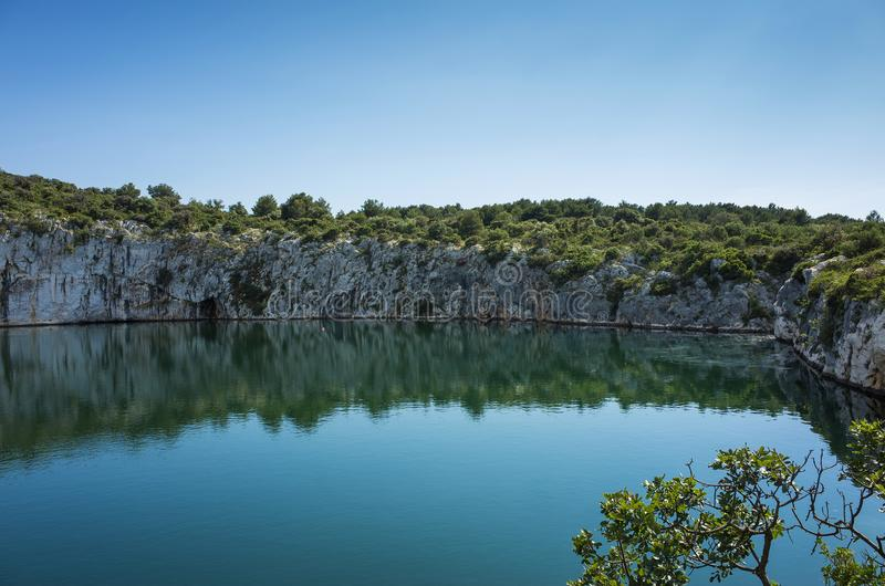 Dragons Eye, Rogoznica Dalmatia Croatia. Beautiful nature and landscape with rocks and cliffs around a small lake. Nice warm sunny spring day with clear blue stock photos