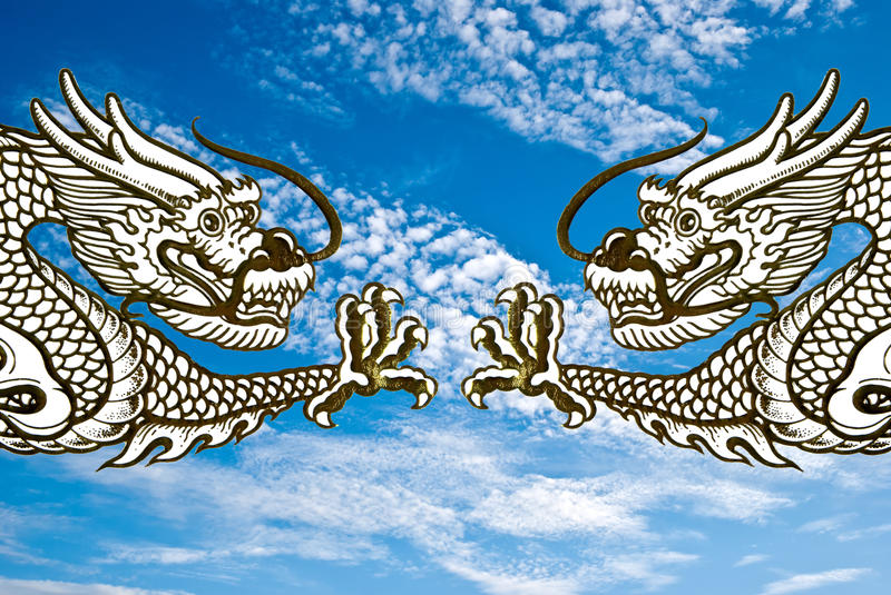 Dragons fly on sky background. Double dragons fly on sky background stock images