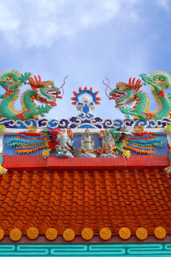 Dragons, ornaments and other religious symbols on a Chinese shrine in Phuket, Thailand. stock photography