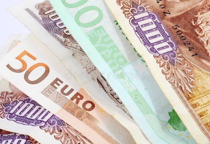 Drahmas y euros imagenes de archivo