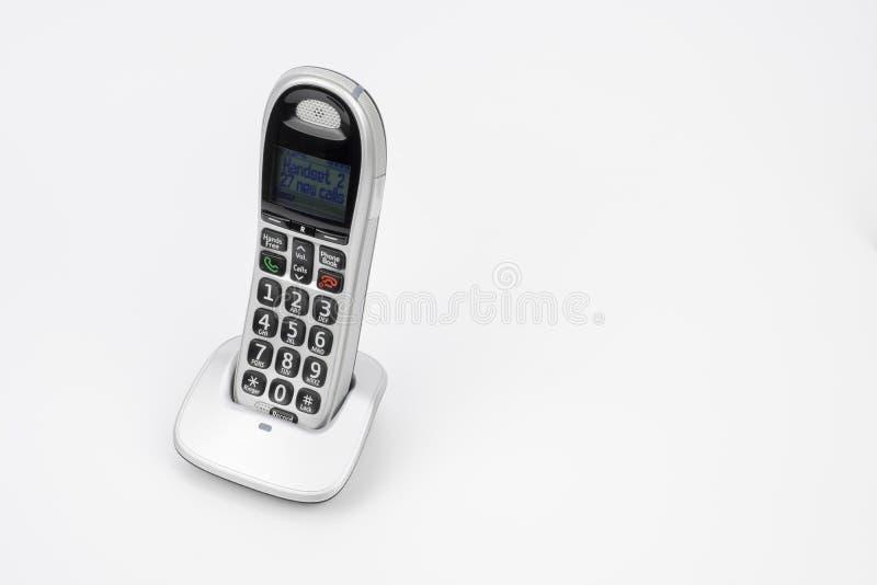 Draht geben Handy frei lizenzfreies stockbild