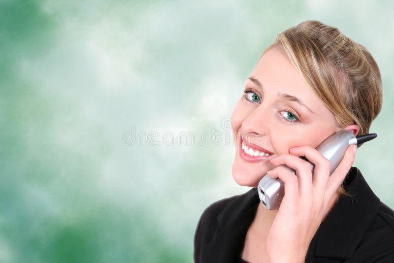 Drahtloses Haus-Telefon-grüne Augen auf grünem Hintergrund lizenzfreie stockfotografie