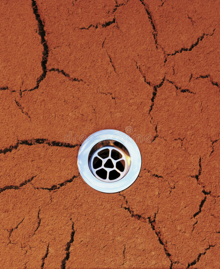 Drain Dry Drought Background. Drain set into dry cracked earth background stock photo