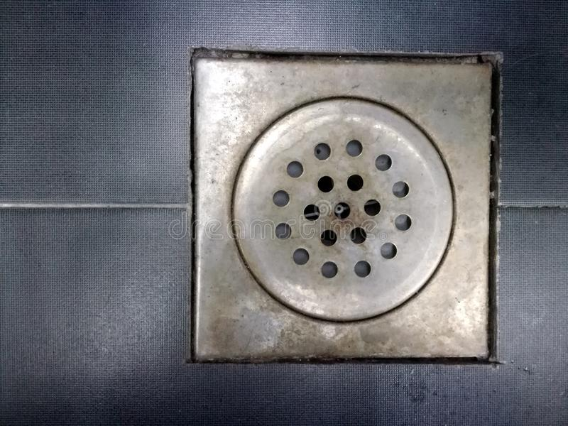 Drain on the floor. Of a bathroom or a kitchen royalty free stock photography