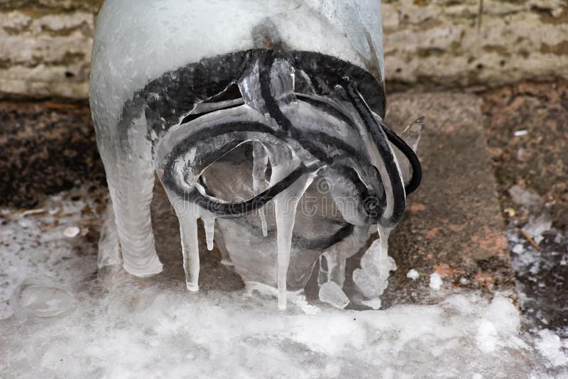 Drain pipe with frozen water and wires. Is close royalty free stock photography