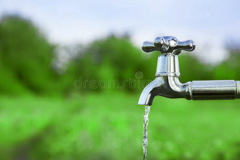 Drain water from the Metal tap royalty free stock photos
