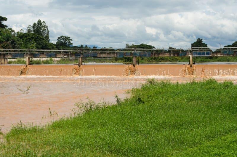Drainage at dam when floods in the rainy season stock photos