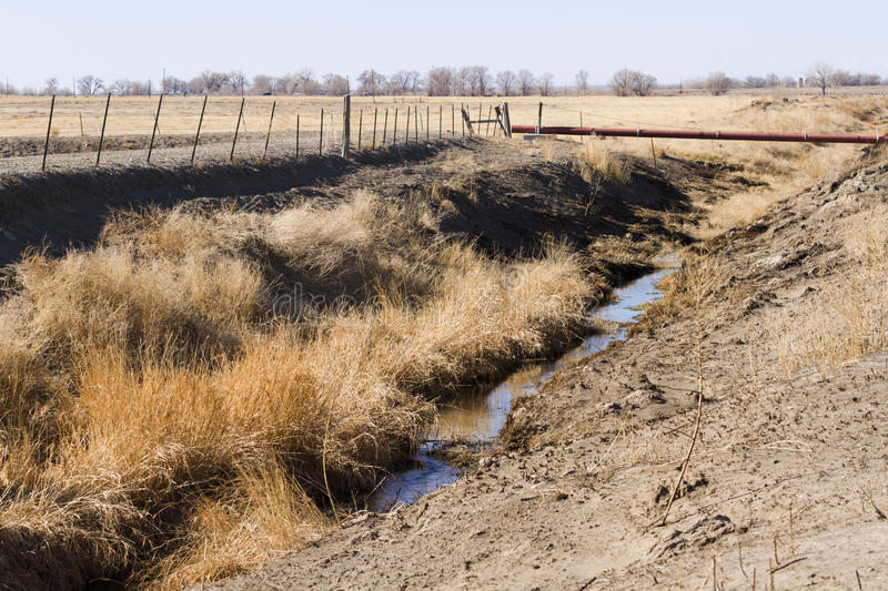 Drainage ditch. Without water. grass stock photography