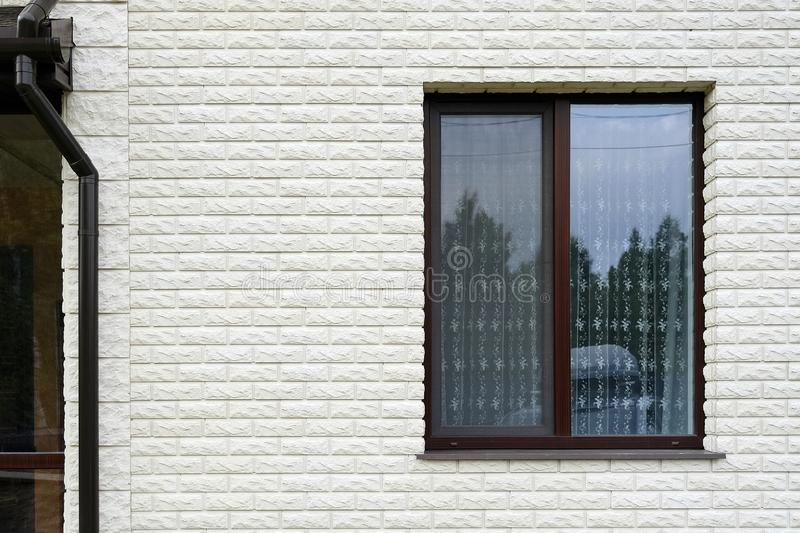 Drainpipe next to the window. Cottage with large panoramic Windows. Glazing of the facade. Drainpipe next to the window. Cottage with large panoramic Windows stock images
