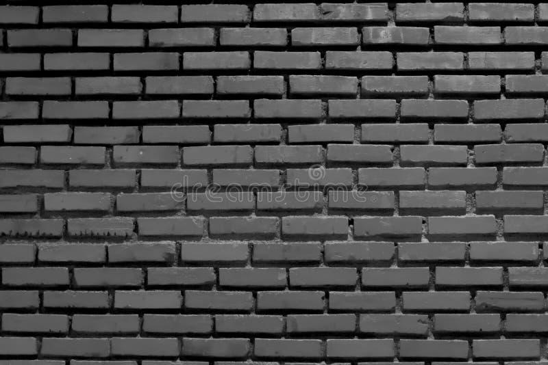 Drak gray brick wall background, texture, horizontal, Create a light dark stock photography