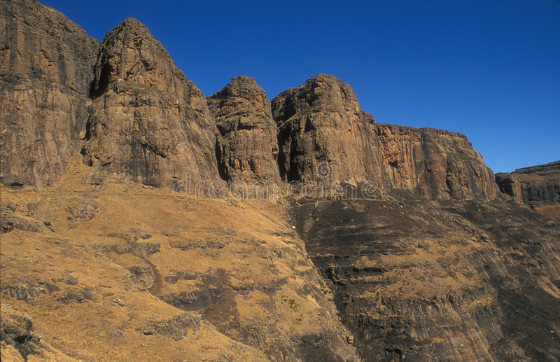 Drakensberg Mountains. Rugged cliffs of the Drakensberg Mountain in South Africa royalty free stock photo