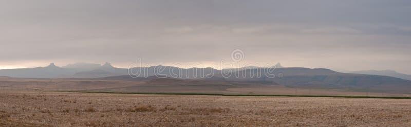 Drakensberg panorama. Drakensberg mountains near Amphitheatre on a cloudy day, panorama of 6 photos stock images