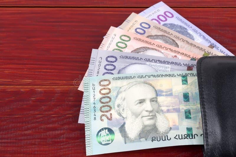 Dram armeno nel portafoglio nero immagine stock