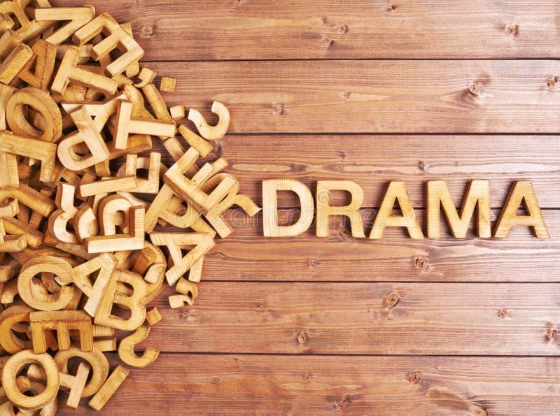 Drama da palavra feito com letras de madeira foto de stock