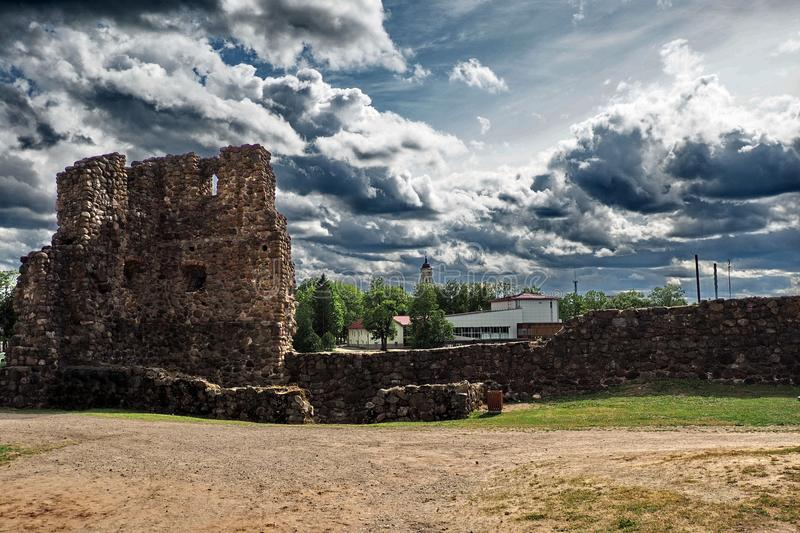 Dramatic тhunderclouds over an old castle stock photography