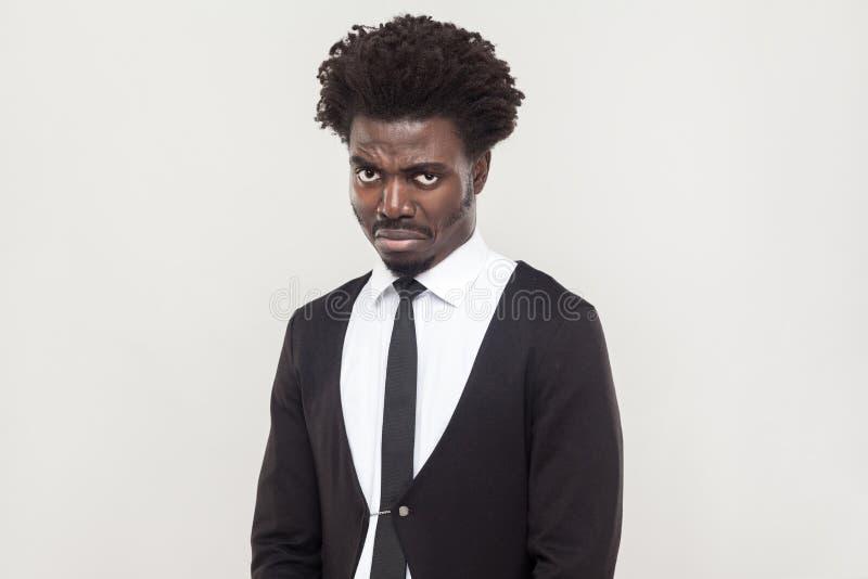 Dramatic afro man cry and looking at camera. royalty free stock photos