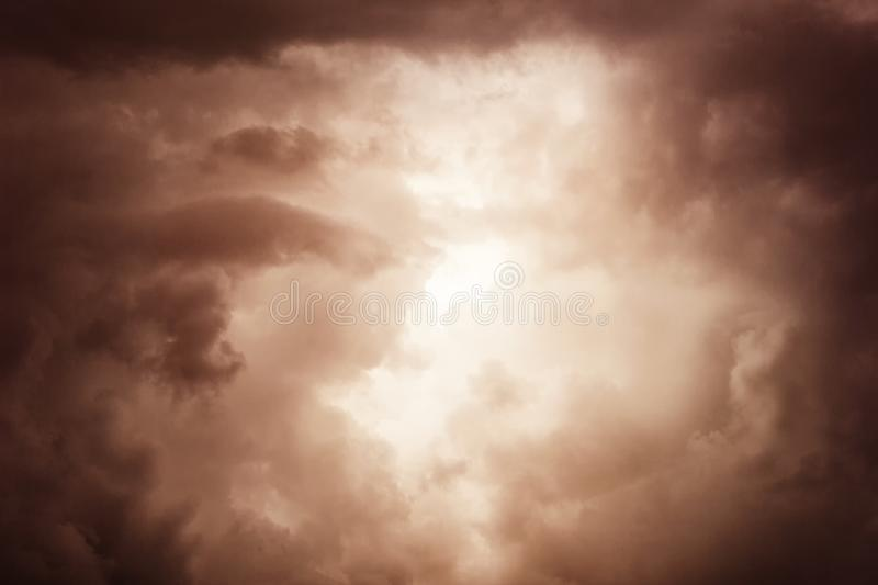Dramatic apocalyptic clouds background with bright lightning in stock photography