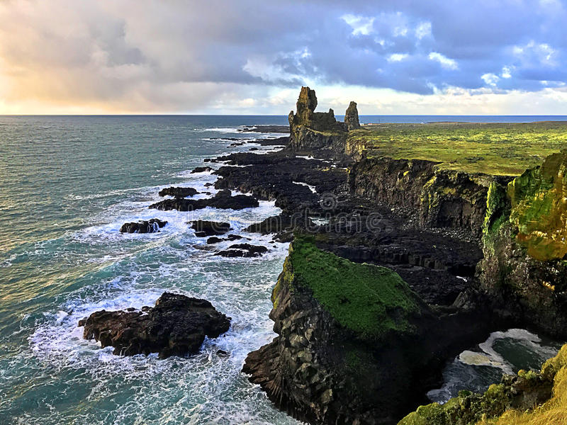 Dramatic basalt cliffs of Longranger Iceland stock images